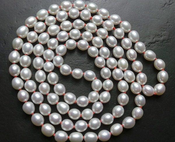 perlentraum-perlenkette-endlos-perlen-kette-unikatschmuck-oval-faden-orange